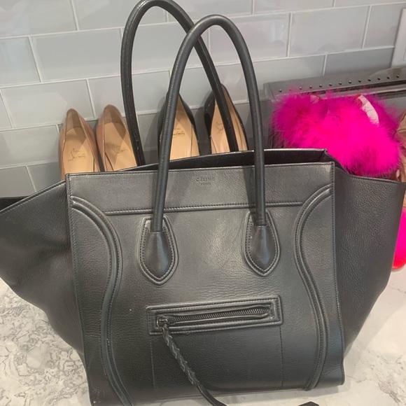 Celine Handbags - Authentic all black leather Celine luggage tote.